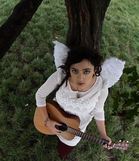 Another fishbowl pic of me under the tree playing guitar with my fairy wings