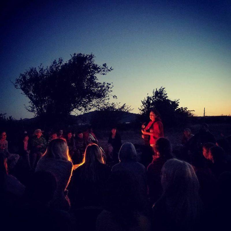 Singing at a campfire