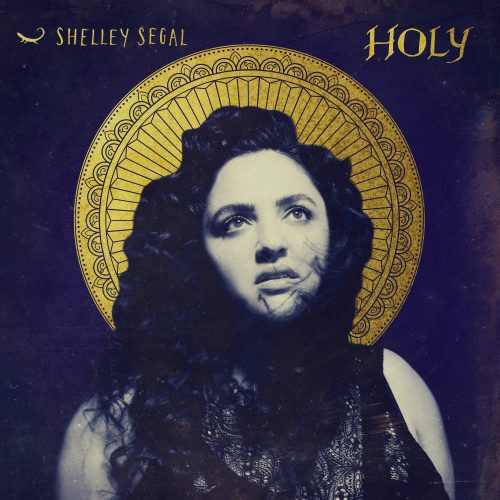 Cover art for Holy e.p. Shelley is facing ahead with a golden halo around her