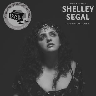 A black and white photo of Shelley, looking up. She's wearing a flowy flower patterned dress, next to a logo of the international songwriting competition, for which she is a semi finalist
